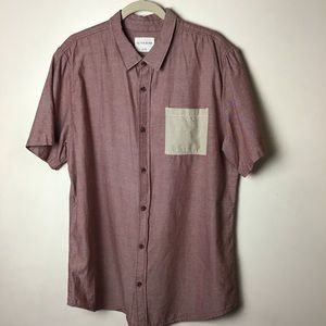 On the Byas red s/s button up shirt. XL